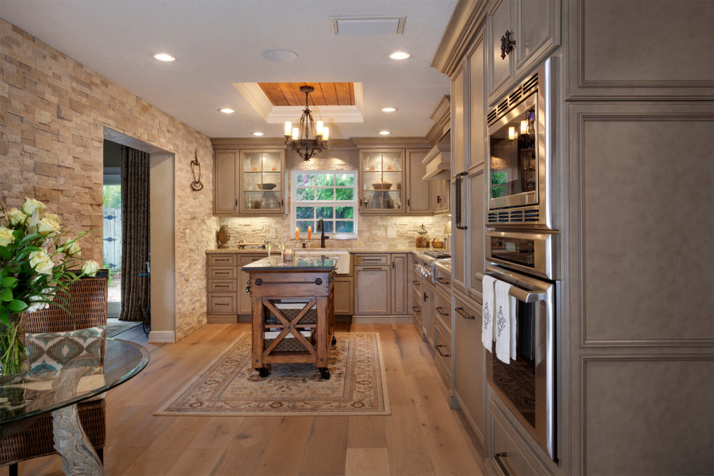 Kitchens and Baths Boca Raton Florida Rustic Hardwood Floors Recessed Ceiling Spot Lighting Wall Oven Windowed Cabinetry Brick Wall